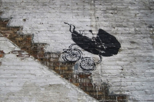 Baby-Carriage-Rolling-Down-Stairs-by-Banksy